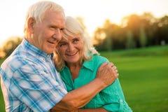 Senior man hugs woman. Royalty Free Stock Photos