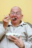 Senior man and ice cream Stock Image