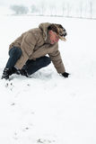 Senior man injured on snow Royalty Free Stock Image