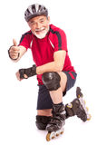 Senior man inline skating Stock Images
