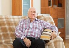 Senior man in interior. Portrait of quiet grizzled senior man in interior Royalty Free Stock Images