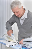 Senior man Ironing clothes Royalty Free Stock Photography