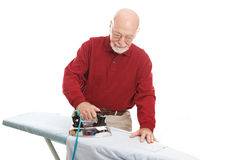 Senior Man Ironing Stock Images