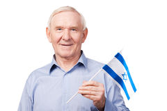 Senior man with Israeli flag. stock photo
