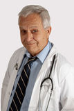 Senior man with a job. Senior grey hair man wearing doctor coat and stethoscope Stock Photography