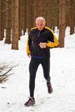 Senior Man Joggin in Snow royalty free stock photography
