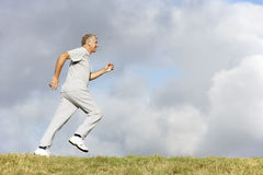 Senior Man Jogging In The Park Royalty Free Stock Photo