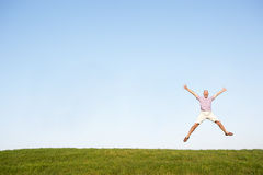 Senior man jumping in air Stock Images
