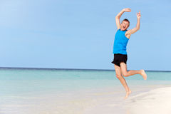 Senior Man Jumping On Beautiful Beach Stock Photos