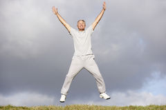 Senior Man Jumping In The Park Royalty Free Stock Image