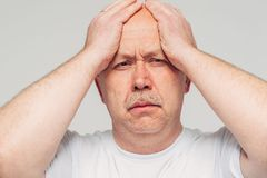 Senior man keep hands on hand problem stress Royalty Free Stock Image