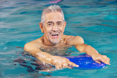 Senior man with kickboard Royalty Free Stock Image