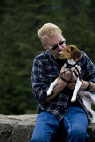 Senior Man Kissing Beagle Stock Photos