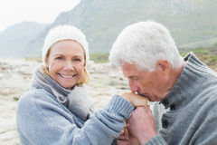Senior man kissing happy womans hand Stock Image