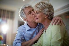 Senior man kissing senior woman Royalty Free Stock Photography