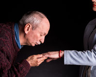 Senior man kissing a woman's hand Royalty Free Stock Images