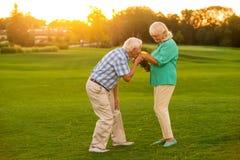 Senior man kissing woman's hand. Stock Photos
