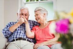 Senior man kissing womans hand Stock Image