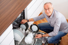 Senior man in the kitchen 9 Royalty Free Stock Photo