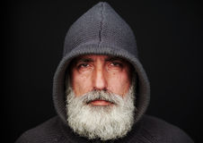 Senior man in knitted jacket over black background Royalty Free Stock Images