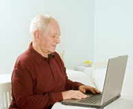 Senior man with laptop computer. At home Royalty Free Stock Photo