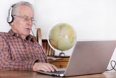 Senior man with laptop Stock Image