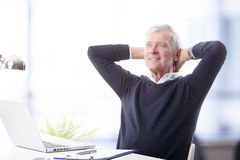 Senior man with laptop Stock Photos