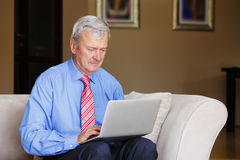 Senior man with laptop Stock Image