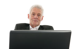 Senior man with laptop Stock Photography