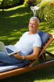 Senior man with laptop Stock Photo