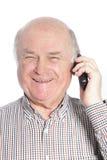 Senior man laughing while talking on phone Royalty Free Stock Photography