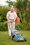 Senior man with lawn mower Royalty Free Stock Photo