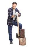 Senior man leaning on an axe Royalty Free Stock Photo