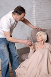 Senior man leaning to his wife royalty free stock photography
