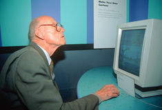 A senior man learning how to use a computer Stock Photography