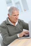 Senior man learning how to use laptop Stock Photo
