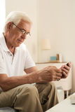 Senior Man Learning to Use Smartphone stock images