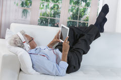 Senior man lenjoying music with headphones Royalty Free Stock Image
