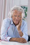 Senior man lenjoying music with headphones Royalty Free Stock Photography