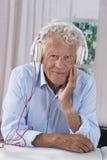 Senior man lenjoying music with headphones Royalty Free Stock Photography