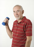 Senior man lifting dumbbell. Smiling senior man lifting barbell on white background royalty free stock photography