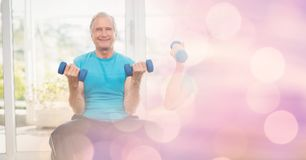 Senior man lifting dumbbells in gym stock photos