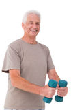 Senior man lifting hand weights Stock Photography