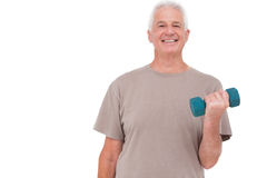 Senior man lifting hand weights Royalty Free Stock Photo