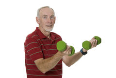 Senior man lifting large weights. Senior man keeping fit. White Background royalty free stock photography
