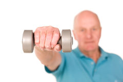 Senior man lifting weights Royalty Free Stock Photos