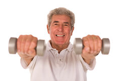 Senior man lifting weights Stock Photos