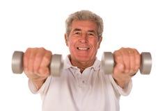 Senior man lifting weights Stock Photos