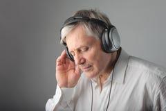 Senior man listening music Stock Photos