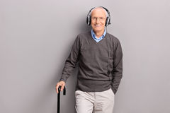 Senior man listening music on headphones Stock Photo